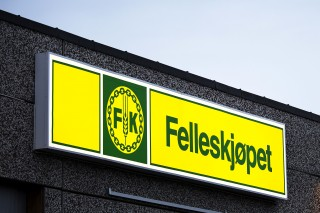 Felleskjopet signage on a wall in Norway