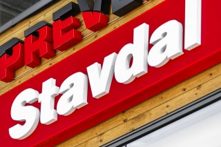 Stavdal white illuminated letters on a red backplate