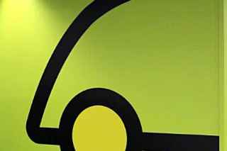 Whole wall logo at a car retailer