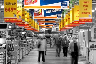 Printed banners hanging from ceiling in a grocery store in Norway